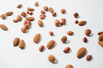 Pattern of nuts mix with copy space. Various nuts isolated on white.
