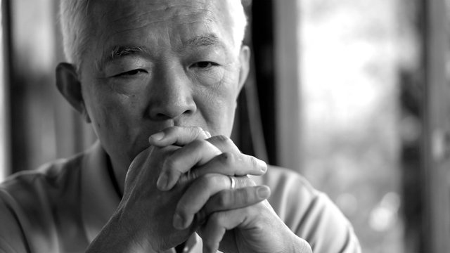 Asian senior man worry stress thinking about life ahead