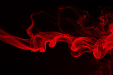 Red smoke abstract on black background. fire design