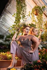 Nice attractive women standing under the flower pot