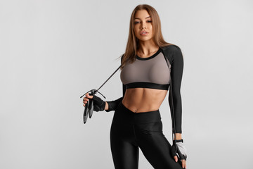 Sexy fitness woman with skipping rope, workout. Sexy athletic girl, sports concept