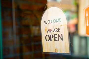 Open sign at restaurant and store