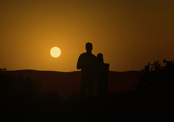 Realistic illustration of a couple of young people, men and women. Hugging at sunset on an orange sky, vector