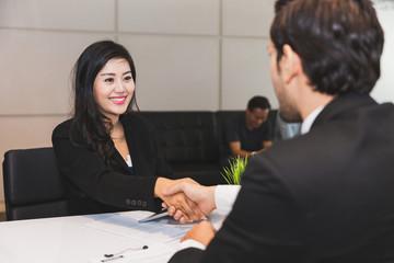 Businessman and woman handshake