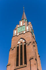 Fotomurales - Tower of the historic Stadtkirche church in Jever, Germany