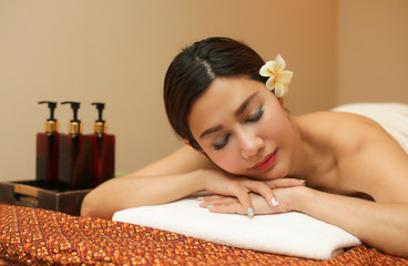 Young woman relaxing in the massage spa.