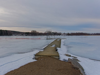 Pier on the lake at winter