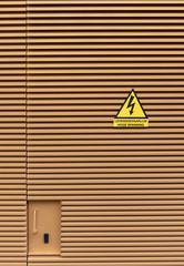 Danger sign on an orange background with lines