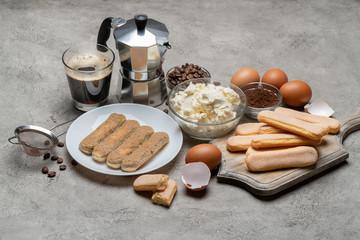 Tiramisu cake cooking - Savoiardi ladyfingers Biscuits, cheese and coffee