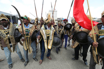 Ethiopian men dressed in traditional costumes dance during the 123rd anniversary celebration of the battle of Adwa where the Ethiopian forces defeated an invading Italian forces, in Addis Ababa