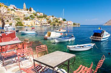 traditional greek tavern on sea shore on Symi island, Greece