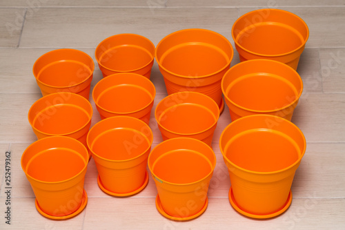 Fotolia & Bright orange flower pots made from plastic for growing indoor ...