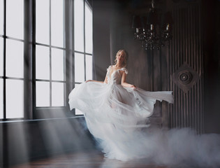 Door stickers Bestsellers Kids sweet and gentle girl with fair skin and blond hair dances alone in silence in an old castle, spirit of abandoned medieval building whirls in white smoke and magical thick fog in rays of sun