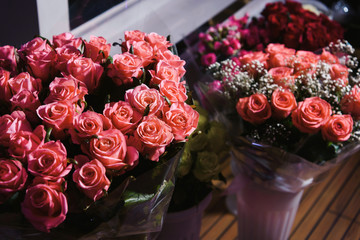 The beautiful bunch of red roses with other flowers was presented to the VIP in the happy birthday party.