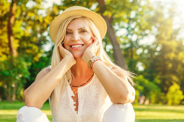 Happy mature woman at the park in summer