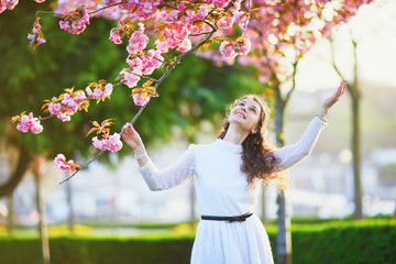 Woman enjoying cherry blossom season in Paris, France