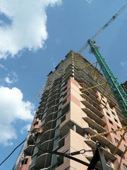house develop with crane tower