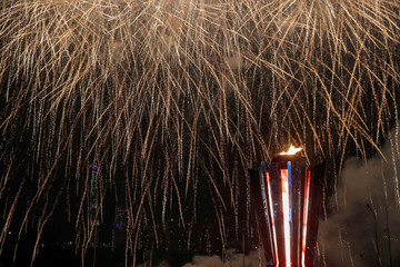 The flame is lit during the opening ceremony for the 29th Winter Universiade at the Platinum Arena in Krasnoyarsk