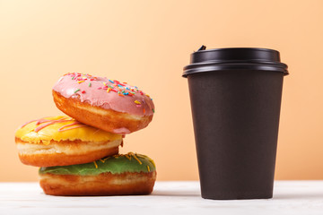 Takeaway coffee and doughnuts,a quick snack along the way. Concept of serving takeaway food for a coffee shop or bakery
