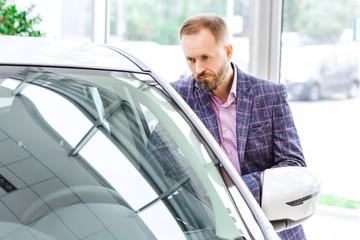 Mature businessman shopping automobile