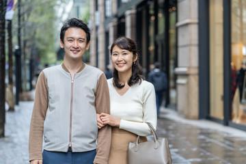 young asian couple walking in shopping street