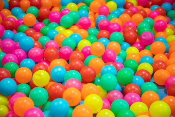 multicolor plastic balls background and texture.