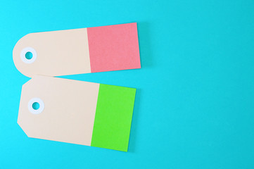 green and orange rectangle paper tags on blue background