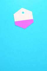 hexagon paper tag on blue background vertical template