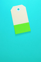 clipped rectangle paper tag on blue background vertical template