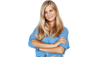 Young beautiful girl woman blond with long hair and blue eyes in a blue shirt isolated white background