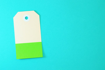 clipped rectangle paper tag on blue background horizontal template