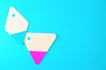 diamond and triangle paper tags on blue background horizontal template