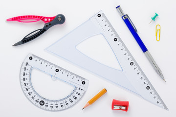 school set and ruler at white background