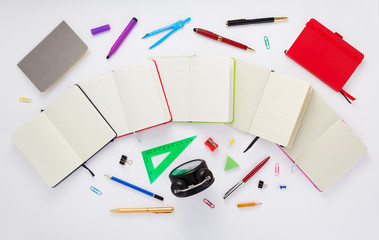 notebook and school supplies at white