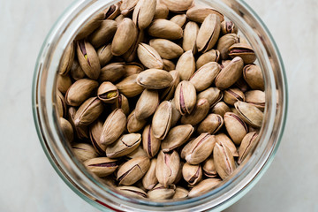 Pistachio Nuts with Shell in Jar / Glass Bowl.