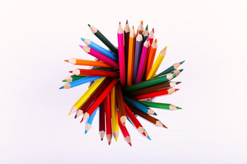 Colored pencils, school supplies for drawing, pattern, copy space.