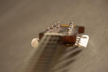 Mandolin in flashlight on gray background.