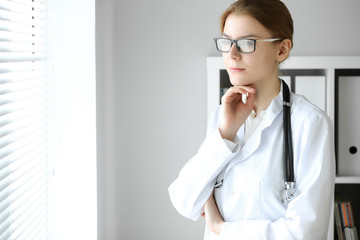 Doctor woman at work. Portrait of female physician at hospital office. Medicine and healthcare concept