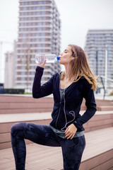 Young woman is refreshed after the training