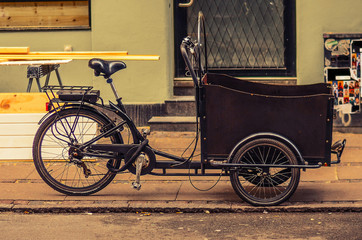 Printed roller blinds Bicycle tricycle (bicycle) bike with a basket on the street of Copenhagen, Denmark