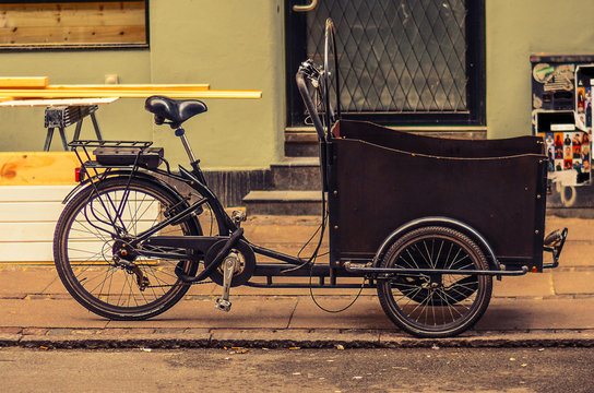 tricycle (bicycle) bike with a basket on the street of Copenhagen, Denmark
