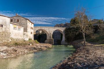 The medieval bridge over the river Metauro in Mercatello sul Metauro (Pesaro-Urbino province)