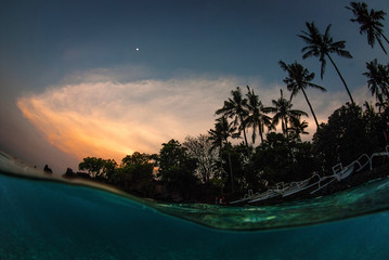 Half water - split. Underwater photography. Tulamben, Bali, Indonesia.
