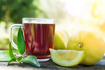 hot red tea cup with lemon