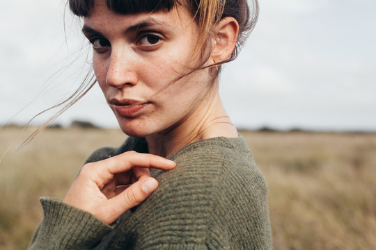 Portrait of young woman standing outdoors