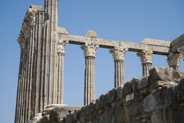 Roman ruins of columns against the blue sky.