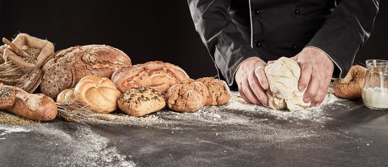 Baker kneading dough to make gourmet bread