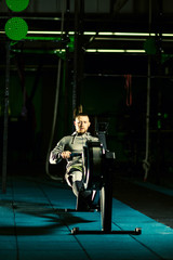 Workout on the rowing machines at the gym