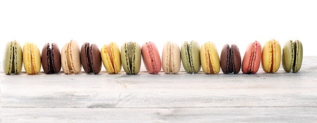Foto auf Leinwand Macarons Sweet and colourful french macaroons or macaron on white background