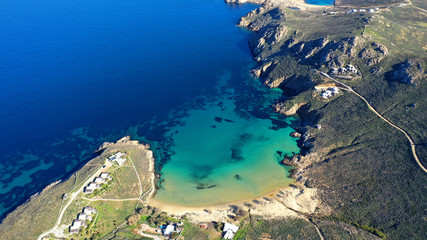Aerial drone photo of beautiful sandy beach with deep turquoise sea of Psili Amos in island of Serifos at spring, Cyclades, Greece